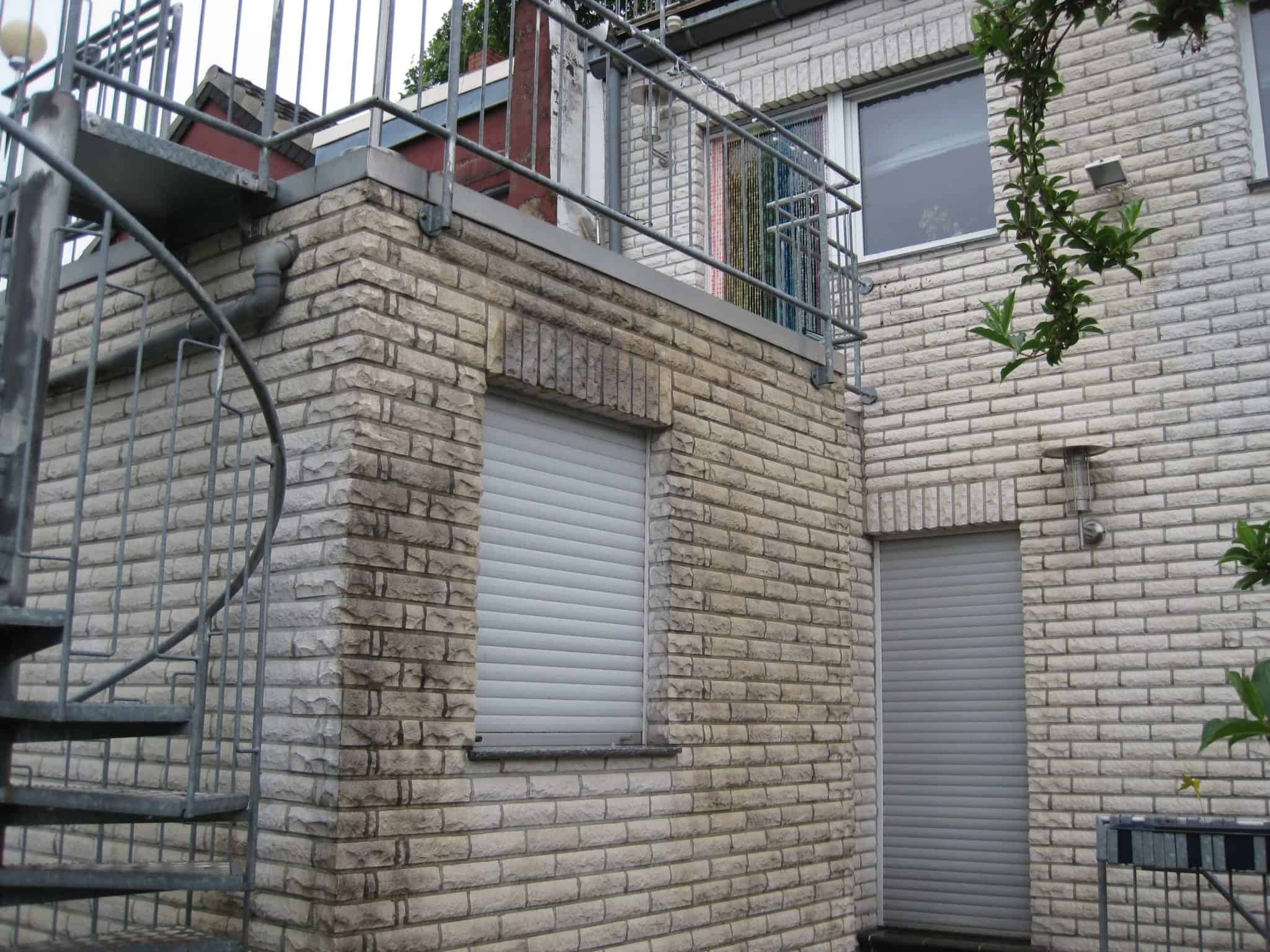 Wir reinigen die Hausfassade